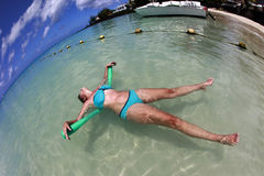 Woman enjoying summer in the ocean on Mauritius Royalty Free Stock Photo