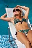 Woman enjoying summer in the pool Royalty Free Stock Photos
