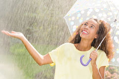 Woman enjoying summer rain Stock Photography