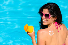 Woman enjoying summer with sun skin protection at swimming pool Royalty Free Stock Photos