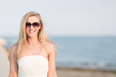 Woman enjoying a summers day at the beach Stock Image