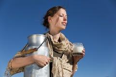 Woman enjoying the sun and their milk Royalty Free Stock Photos
