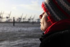 Woman enjoying the sun on a winter day at the river Elbe in Hamburg, Germany stock images