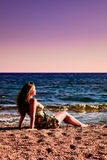 Woman enjoying sundown at beach Stock Photo
