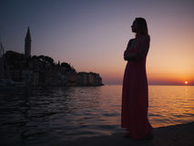 Woman enjoying a sunset in a Rovinj, Croatia Royalty Free Stock Image