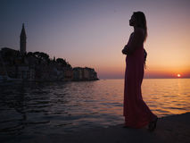 Woman enjoying a sunset in a Rovinj, Croatia Stock Images