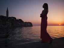 Woman enjoying a sunset in a Rovinj, Croatia Stock Photo
