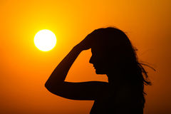 Woman enjoying sunset Stock Photos