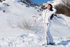 Woman Enjoying Sunshine While Skiing on Snowy Hill Stock Photo