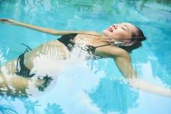 Woman enjoying swimming royalty free stock photos