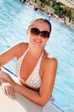 Woman enjoying a swimming pool Royalty Free Stock Images