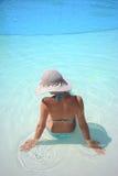 Woman enjoying a swimming pool Stock Photo
