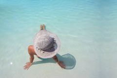 Woman enjoying a swimming pool Stock Image