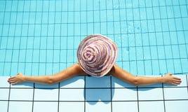 Woman enjoying in swimming pool Stock Photo