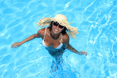 Woman enjoying a swimming pool Royalty Free Stock Photo