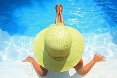 Woman enjoying a swimming pool Stock Images