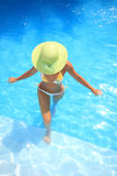 Woman enjoying a swimming pool stock photo