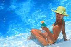 Woman enjoying a swimming pool stock photos
