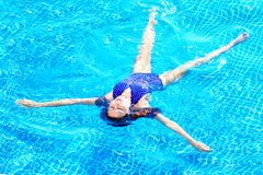 Woman enjoying a swimming pool, relax in water. stock photos