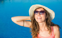 Woman enjoying by the swimming pool Stock Photography
