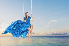 Woman enjoying swing Stock Image