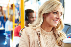 Woman Enjoying Takeaway Drink On Bus Journey Royalty Free Stock Photography