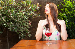 Woman enjoying time on terrace with glass of wine Royalty Free Stock Photography