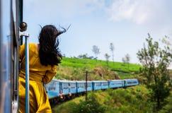 Woman Enjoying Train Ride Through Sri Lanka Tea Plantations Royalty Free Stock Image