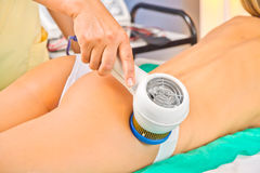 Woman enjoying the treatment in a Spa center Royalty Free Stock Photo