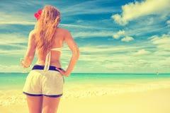 Woman enjoying tropical beach relaxing joyful in summer Royalty Free Stock Photo