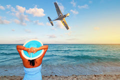 Woman enjoying tropical holidays stock photography