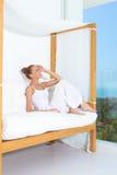 Woman enjoying tropical luxury Stock Images