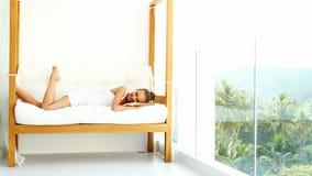 Woman enjoying tropical luxury Royalty Free Stock Photos