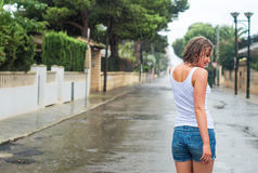 Woman enjoying tropical rain. Stock Photos