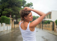 Woman enjoying tropical rain. Royalty Free Stock Photos