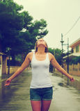 Woman enjoying tropical rain. Happy blonde woman enjoying tropical rain stock photography
