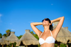 Woman enjoying tropical resort caribbean vacation Stock Image