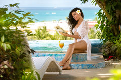 Woman enjoying  in tropical vacation Royalty Free Stock Images