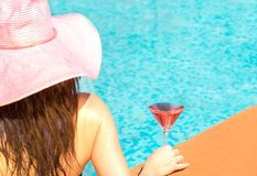 Woman enjoying vacation in a swimming pool Stock Images