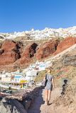 Woman enjoying vacations at world famous Oia village or Ia, Santorini island, Greece. royalty free stock photos