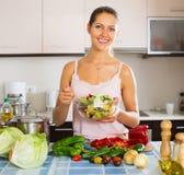 Woman enjoying vegetable salad Stock Photos