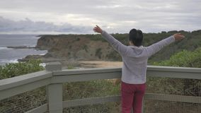 Woman enjoying view of Australian beach landscape stock video