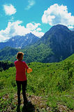 Woman enjoying the view of the mountains. Tired female tourist enjoying the view of the mountains Royalty Free Stock Photo