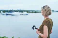 Woman capturing herself with personal camera Stock Photography