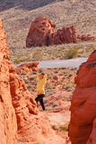 Woman enjoying view of red  rock formations in Valley of Fire St Royalty Free Stock Images