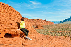 Woman enjoying view of red  rock formations in Valley of Fire St Stock Images