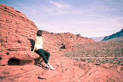Woman enjoying view of red  rock formations in Valley of Fire St Royalty Free Stock Image