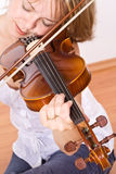 Woman enjoying violin music Stock Images