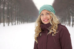 Woman enjoying walk along snow covered alley Royalty Free Stock Photography