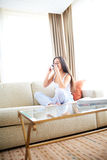 Woman enjoying a warm drink and relaxing. Royalty Free Stock Photography